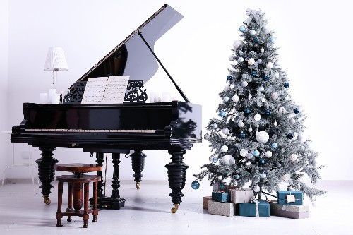 A piano sits without being used during the winter holiday season.